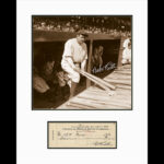 Babe Ruth in Dugout with Check